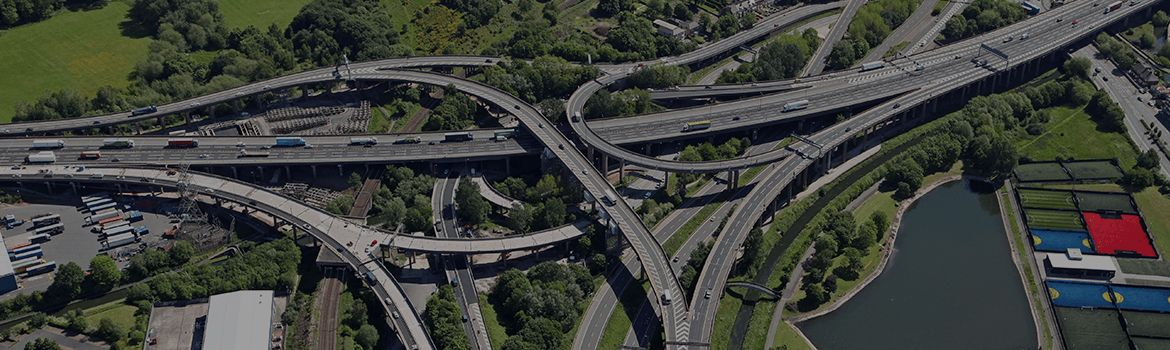 About Us: Cars driving on overlapping roads on the motorway.