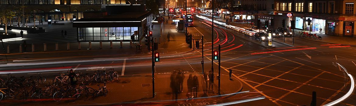 Testimonials: A busy street at night capturing the red lights of the traffic.